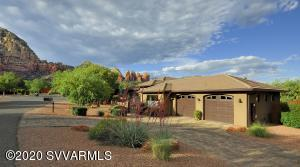 Golden opportunity to own a pristine Southwestern style single level home located in the heart of Sedona! Entry way opens into a spacious Great Room with Juniper mantle fireplace and huge North facing windows that showcase the incredible view of Thunder Mountain. Kitchen has natural gas range, granite counters and beautiful custom cabinetry. This one owner home has tasteful ceramic wood plank and large square tile flooring throughout. Dual door entry to the Master Suite, luxurious soaking tub and awesome Red Rock views! A true four bedroom home with circular paver driveway, oversized two car garage and large, private fenced in back yard with room for a pool if so desired. Truly the best home in this price range so make your move before it's too late! Call for a private showing today.