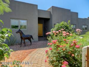 First time on the market 3 bedroom 2.5 bath custom home includes a family room, dining room and an office.The Cul De Sac location in the desirable Pinon Woods area offers privacy and convenience to all of Sedona's amenities. The free flowing floor plan features hard wood and tile floors, Pella between the glass shades on all the windows, solid interior doors, and granite throughout. Highlighting the food lovers kitchen are alder cabinets, sub zero refrigerator, wolf range and an island. The private fenced back yard, covered patio and raised garden beds overlook a wash offering unique wildlife viewing opportunities. A paver driveway leads to a double deep 1500 sq ft garage that can hold four vehicles. Red Rock view from the front courtyard. Owner is lic. real estate agent in state of AZ.