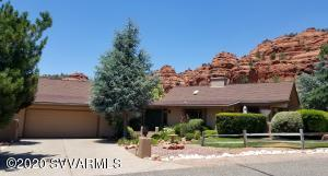 ELEGANT HOME WITH STUNNING VIEWS in a Highly desirable neighborhood! Enjoy the privacy from one of your patios while gazing upon the Red Rocks or counting stars. This immaculate home had a very detailed remodel with costs exceeding $300,000. You can see the care taken throughout the property. This home is more than you have been looking for. From the switch plates to the ceilings, the beautiful flooring to the newer windows, and the Wolf appliances to the Custom Plantation shutters. There is even a 3 Sided gas fireplace that warms the flowing main floor entertainment area. Top it off with an oversized garage that has a large workshop at the back, big enough for a golf cart, art studio, or ???.