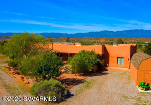 A New Price! A Real Opportunity! Privacy, Views & More. A safe haven w end of the road peace & tranquility, this beautiful spacious 3039 SF Sante Fe style home sits on 1.94 usable acres at the top of Angel Crest Dr. Panoramic views from the Black Hills to Sedona pour through large picture windows throughout the home. Magical sunsets & soaring hawks are daily gifts on your log pole back patio. Have pets, a 1/2 acre fenced back yard, sprinkled w fruit trees, offers freedom to roam. There's a fabulous 1700 SF, heated/cooled, garage & workshop for all your hearts desires. You have plenty of off street parking for your toys & an RV hook up. AND there's still over an acre with amazing unblockable views. This is a unique, very special property w so many possibilities. There's more...