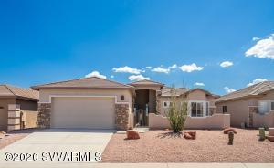 Upgraded and well maintained home in Verde Santa Fe shows like a brand new home. Over-sized 2 car garage, bright, open split floor plan with beautiful, unblockable views of Mingus Mountain from the master bedroom, dining room and living room! Backs to forest service land with hiking trails out the back door. Kitchen has upgraded granite counters! Large master bedroom with a walk-in closet. Tile floors throughout the entire home! 10ft ceilings everywhere!  Amante boast a community pool, Public 18 hole golf course, (Agave Highlands) as well as gym and clubhouse! Close to Cottonwood and Sedona!