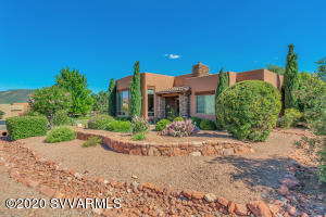 Immaculate Santa Fe style Sedona home with knockout views from this single level home that's been well maintained and landscaped to provide privacy. High ceilings and massive windows showcase red rock views from this newer home with walk out rear patio perfect for morning coffee or evening relaxing after hiking the nearby trails . Three bedrooms plus an office (or 4 bedrooms if needed) with split bedroom plan to give the owners privacy from family or guests. Open floorplan means the kitchen is open into the living room - great for livability and perfect for entertaining. Modest monthly HOA fees cover all exterior landscape maintenance, making this home fantastic for a primary residence with no landscaping needed or a perfect lock-and-leave second home.