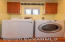 Sweet little laundry room just off the kitchen with a new top-load washing machine - also freshly painted - the the left of the dryer is a petite powder room 1/2 bathroom with pocket door privacy