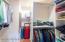 Nicely designed closet with plenty of shelves & hang bars - storage is no problem