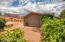 Stunning views to Courthouse Butte! Large side yard with plenty of room for raised garden beds. Double door on side of garage for golf cart parking