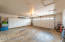 Fantastic over-sized 2-car garage with plenty of room for sports equipment - excellent cabinets for additional storage, tools & home improvement supplies