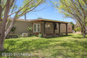 Quiet property at end of dirt road.  Located 20min from downtown Cottonwood.  Sit in the front yard and watch the amazing panoramic sunsets or play with your kids in the backyard among the lush grass and mature shade trees. This house is perfect for entertaining with 2 huge living rooms, open concept kitchen, light laminate floors and french doors opening onto a covered patio.  Plenty of space to raise chickens and horses and still have room to grow a garden. Space for RV too!Seller is licensed real estate agent in Arizona