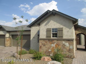 ATTENTION INVESTORS or Future Clarkdale Residents - Model Leaseback Opportunity perfect for a financial investment or your future dream home! The Star Gazer at Mountain Gate is expertly designed for energy efficiency, durability & comfort. This is a magnificent floor plan. Every detail of this home has been thoughtfully considered. The spacious Great Room is perfect for entertaining & opens out to the covered patio.  Elegantly appointed kitchen with upgraded cabinetry, exquisite quartz counters & gourmet stainless-steel appliances. Elegant tile throughout. 2nd bedroom is Ensuite with Den nearby. Owner's bathroom has enormous custom tile walk-in shower.  Garage is 3-car bay with 4th tandem space. Solar panels & energy storage INCLUDED. Ask about potential tax savings. Aerobarrier & whole...