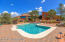 Poolhouse conveniently located beyond pool.