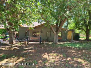 Amazing  8+ Acre Ranch located in the heart of the Verde Valley! The Property fronts Oak Creek at the back,  Cornville irrigation ditch on the front,Has Well, RV hook up, sprinkler irrigation. fenced and cross fenced,raised beds in garden, Huge garage/barn 2 story,2nd red tack/barn, electric front agte, fountain, private courtyard,Kiva fire place on covered front patio, rustic huge storrage shed, property fronts Oak Creek, tall trees, green grass, Kiva fireplace in great room, formal dining room, huge kitchen with granite breakfast bar, ,walk in pantry,Carpet, stone,and hardwood floors, vaulted ceiling in great room,huge walkin closet in master bd rm,R-O drinking water , all appliances stay, built in rustic book cases in living rm. fantastic views, peaceful Country living at its Best!