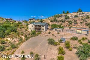 Fabulous property on a hill with expansive  views of the Verde Valley including Mingus Mountain, Jerome, & the Red Rocks of Sedona. Easy access to trails, the Verde River. and Old Town Cottonwood. This beautifully maintained Southwest home features living room, dining room, kitchen and master suite on main level with a 10x25 deck.. Lower level has pvt entrance, family rm, 3 bedrooms which can also be used for other purposes - hobbies, studio, library, etc; a bathroom, utility room, and a 10x12 covered deck. The 1.1 acre property also contains a shed/art studio fitted with insulation, electric and window A/C,   an electronic fence,  an open shed and a storage shed which can be used as horse facilities. Suitable for 2 horses. Space for RV parking. Short term rental ok.
