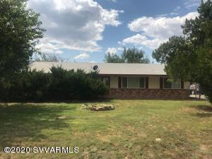 This property is multi-use. This Camp Verde commercial zoned C2-4 property features a 1,680 sqft. Site Built Home, Well, Guest House, Detached Garage & Carport. Horses, Domestics, Farm Animals OK