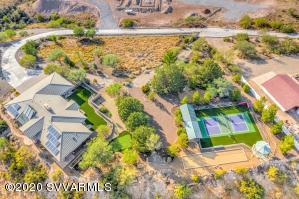 THE GEM OF THE SEDONA VERDE VALLEY!This custom, one of a kind home will take your breath away, with the best views of the entire valley, red rocks and mountains. Tucked away at the end of a private road and just 10 minutes away from Historic Old Town,  peace and tranquility reign.Whether you enjoy practicing your putts, playing pickle ball or petanque/bocce ball with friends and family or just kicking back and watching the beautiful horses training at the Equestrian Center below, you will find it hard to leave.Mature trees and exquisite, carefree landscaping, are the perfect setting to enjoy your time away from the hustle and bustle of the world.MOTIVATED SELLER!!