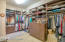 Wrap Around Walk In closet with built ins in Master Suite