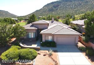 Gorgeous like new custom home located on the ninth hole of the Sedona Golf Resort with red rock views. This home is located on Upper Crown Ridge and shows like a model. This 3/3/study Jerome plan has custom upgrades. Please see Supplement for additional information. Please CALL LO or LA prior to showing to schedule.