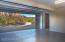 Garage with door to 4th bedroom or office