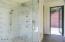 Walk-in shower and door to back patio