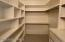 Large walk-in closet in upper level bedroom.
