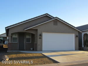 Built in 2019 this like new 2 bedroom 2 bath bungalow has an open floor plan. Dining room with built in shelving. Open & bright kitchen has SS appliances, tiled backsplash, breakfast bar and granite countertops. Living room has ceiling fan & cathedral ceiling. Laundry closet in hallway. Primary bedroom has slider door to backyard, barn door detail to en suite. En suite has dual vanity, walk in shower and attached walk in closet. Spacious 2nd bedroom with guest bath right next door. Front & back covered patios allows you to relax and take in the mountain views or a beautiful AZ sunset/sunrise. Backyard has installed seating bench. Double garage, water recirculator, low maintenance yard. At the base of Mingus Mountain w/ peekaboo canyon red rock views come enjoy all the area offers!