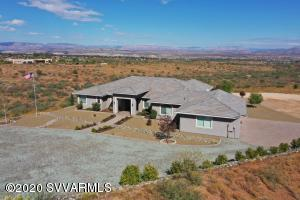 With jaw-dropping, unobstructed views of Sedona and the Verde Valley you won't want to leave this well built custom home! Located in the exclusive, gated Quail Canyon Subdivision, this 1.76 acre property borders state trust land. The home boasts a covered porch that is over 650 SF, with a pathway that leads to the gas firepit - allowing you a beautiful view all along the way! No expense was spared when building this home. The chef's kitchen offers expansive counter space, island seating and beautiful built in stainless steel appliances. The attached 3 car garage has an epoxy coated floor, elevating the feel of the garage to match the high-end nature of the entire home! With all these upgrades, you couldn't build this home for the price!