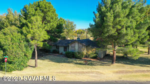 Remodeled home sits on a lush flood irrigated 1+ acre partially fenced corner lot. Easy access to the Verde River where you can enjoy kayaking or fishing.  The home has a beautiful kitchen with custom Knotty Alder cabinets with pot drawers, beautiful Corian counters, 2 large pantries & an eat-in bar area.  Kitchen & dining room have beautiful wood plank flooring. Vaulted ceilings & picturesque windows in the living room bring in so much light. The basement is 540 square feet,  over 1/2 of it is finished while the other 1/2 is perfect for extra storage. The property has beautiful grass area, & landscaped with apple, plum and pecan trees. Back patio area has a retractable awning. There is a cute metal workshop complete with concrete floors, electricity & has water run to it.