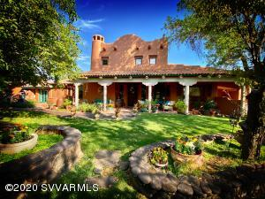 Hacienda de la Mariposa is a one of a kind, authentic Spanish style estate. Featuring two stunning homes with 7 bedrooms, 7.5 bathrooms and 7 fireplaces. Enjoy private trails up & down the spring fed creek with an abundance of wildlife including fish, elk, deer and migrating birds. This is a rare opportunity to own such a slice of heaven! This estate encompasses 4.45 lush acres along Beaver Creek w/ giant shade trees, orchard, gardens, 4 ponds & water features, Mexican Chapel w/ fireplace, wine cellar, horse stables w/ fenced pasture, 16'x40' swimming pool & cantina, water garden, dock, 2 wells, 3 septic tanks & much more. There is a beautiful privacy wall around the property w/ a magnificent butterfly gate. There is an additional site to build another home. It's absolute peace & serenity.