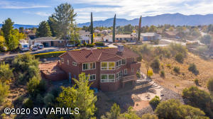 Want views like no other? This little abode near Mingus Mountain showcases iconic red rocks views and close to trails for your weekend activities. A separate entrance to downstairs allows for an airbnb option or separate living quarters for family members! It even has a separate kitchen. Stainless steel appliances, lifetime roof and windows and no HOA make this home a real unique find. Just painted! The fenced yard allows you privacy but time outdoors to enjoy the weather Northern Arizona has to offer. Beyond this, a gas fireplace, bamboo flooring and dual thermostats make you feel like you're living in luxury. Which you are! Lastly, RV parking gives you space for all of your hobbies! Check this one out today.