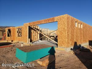 Brand New home under construction in the fantastic Crossroads subdivision. Views, views, views. 3 bedroom/ 2 bath, split floorplan. Upgraded cabinets, the finest quartz counter tops in kitchen.  Vaulted ceiling. Kitchen appliances included. Upgraded tile floors in living room, kitchen and baths. Bedrooms will be an upgraded laminate flooring. front and rear landscaping with a paver driveway. Stucco. 2 year builder warranty. Home will be completed in approx 3 months. Buyer still has time to potentially choose colors.