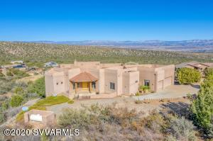 Spectacular unobstructed panoramic views in all directions, this custom built home features 3 bed, 3 bath, 3 car garage, has formal dining room, breakfast room, gourmet kitchen with walk-in pantry, open family/great room, oversized laundry/hobby craft room, plus a separate den/study. There is also a bonus Garage shop located under the home that offers plenty of storage space and used for work room/shop. This space has a separate gated driveway that leads to a garage entry door, perfect for parking ATV'S or quads. Expansive side entry 3 car garage, also plenty of extra parking on the property. This property offers amazing views of Mingus Mountain and Sedona and the peaks of Flagstaff.