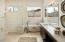 Sundance model home master bathroom with tub