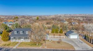 Beautiful Custom Home, on One of The Sweetest Streets in Camp Verde. This Home  is on over 3/4 Acre,  in a Rural Setting, with Stunning Mountain Views, on a Private Paved Road with only 6 Homes Surrounded by White Picket Fences.  2x6 Const. , 20 ton AC, Back Up Generator, 2 Huge Oversized Garages,  Raised Gardens, Fenced  and Cross Fenced.  Heated Front Porch for those Chilly Evenings, Huge Back Porch with Fans for those Hot Summer  Days.  3262 Under Main Home Roof + an additional  720 in Detached Garage. Granite Kit Counter Tops, Maple Cabinets with Pull Out Shelves and Extra Deep Drawers.  Home Office, Could be Used as an Additional Bedroom. Large Master Bedroom with Walk-In Closet, and Huge Whirlpool Tub- 80 gal hot water heater. Owners Spared No Expense on this Charming Home.