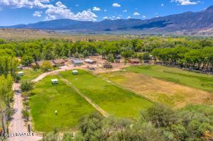 Beautiful Peaceful Ranch on 8.55 + - Acres of Underground Ditch Irrigated Land. Entire Property has Clear Creek River Frontage. 1 Luxury Custom Home with 3,600 Sq. Ft. 1 Manufactured Guest Home with 2,052 Sq. Ft. All living space is on main floor. Bonus room or 5th Bedroom is upstairs. Hickory Cabinets. High Ceilings. 2 Gas Fireplaces. Attached Extended 3 Car Garage. Fenced and Cross Fenced Separate Beautiful Lush Grass Pastures. 2 Horse Barns. Hay Storage. Huge Trees and Fruit Trees line the property.