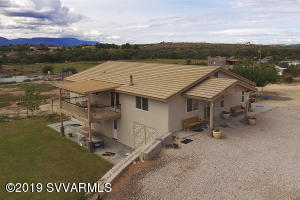 Great views, backs up to Forest Service. 5 bedrooms, 3 bath. Large families welcome. Approximately 2.8 acres, bring horses, toys just about whatever you want. Custom Home built in 2013, Tile roof, wood look tile in main living area. Large shop/garage workshop space on lower level.