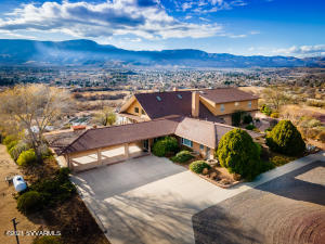 Spectacular one of a kind property in the Verde Valley. Stunning 360 degree majestic panoramic views of the red rocks of Sedona, Mingus Mountain and the green belt of the Verde River. One bedroom guest house with separate entrance adjoins the main house. Open floor plan with vaulted ceilings. Expansive windows for your incredible views. Two fireplaces. An abundance of patio space for your outdoor entertainment. Accessory building is approximately 5980 sq ft. and has a loading dock. This building was used as a dentist office/dental lab for many years. See document tab for additional information on the accessory building. Storage shed on property.Parcels 406-45-036A, 406-45-036C, and 406-45-034G included in the sale of this property.