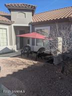 Rare! Must see, Hard to find remodeled town home with golf course views in private, gated community (Verde Santa Fe) Remodel includes; painting (inside and out) new fan/light fixture. satin nickle hardware, apoxy garage with finished baseboards, upgraded kitchen and bathroom cabinets. wood laminate kitchen flooring. 18X18 tiles,  kitchen and bath room tiles. new patio sliding door very large, newly landscaped yard.  The backyard has morning southwest views exposure, and the afternoon hours are shaded.  New, upgraded carpet on order. Indoor and out door furniture is also for sale. Transferable Home Owners Warranty included in sale.  Walk across street to gated, heated pool.   This is a must see