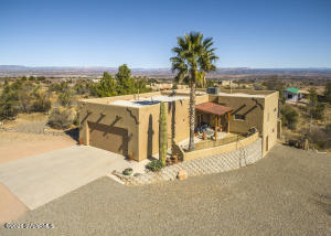 Come see this beautiful southwest home, located around the desirable foothills of Mingus Mountain. Entering through the large welcoming front door you will be struck by the lovely natural light and relaxing setting.  Enjoy red rock sunsets from your spacious great room with open floor plan, large windows, high ceilings and custom concrete flooring. The kitchen is beautifully presented and includes plenty of counter and storage space along with granite counterops.Master suite is large with attached bathroom. Relax in your sunken tub or walk in shower. Wake up in the morning and enjoy a cup of coffee while watching the sun rise off your own private deck. The property is partially fenced, has RV parking, plus a large unfinished basement. You don't want to miss out on this beautiful home.