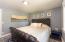 The first bedroom has beautiful furnishings, laminate flooring....