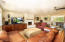 Nicely integrated open living room with a fireplace, quality laminate flooring, high-end built-in cabinetry...