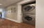 Proceeding from the living space is the hallway to the bedrooms and include the laundry nook with quality washer/dryer...