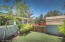 The rear outdoor area has covered every need an owner has from the enclosed area for pets...