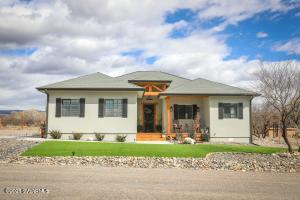 This beautiful 3 bedroom, 2 bathroom custom home in Camp Verde, AZ is waiting for you! Come discover all the upgrades, custom features & added finishing touches. Rural setting with mountain views & access to Clear Creek. Fully landscaped with artificial grass, crushed rock, plants & paver patio. RV parking/dump. Enough space to build an accessory building. All electric home is great candidate for solar. You will be impressed with the 10 ft ceilings, 8 ft doors, custom bathroom vanities, highly upgraded light & plumbing fixtures, & custom tile shower with glass barn door. Laundry room boasts custom cabinets & sink. Relax in your living room as you enjoy the added ambiance of your electric fireplace & character of the reclaimed barn wood. End the day with the sunset from your front porch!