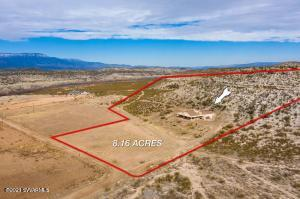 8 acre sanctuary with private river access. NO HOA! Located at the end of a one way street surrounded by Coconino National Forest  on 2 sides. Recent 2018 extensive remodel of kitchen,  appliances, additions, M bath, loft, technology, etc. Perfect for horses, kids, hiking, biking, kayak, off road vehicles,, gardening, create your dream! 2 VERY large bedrooms, each with adjoining rooms & own AC/Heating units. Huge upstairs loft (has kitchenette, bathroom and very large deck) possible hobby room, office, rental, in-law unit, 4th bedroom.  Panoramic views in an area of farms and ranches. House designed around a delightful courtyard with firepit and Bose speakers for music. Hill on back of property has historic Indian Caves and Ruins. If you want wide open space and privacy, this is i