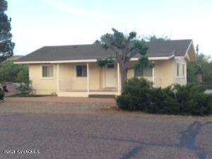 Cute home in heart of the town of Camp Verde. Home sits on large corner lot. creek views Nearly all new inside and out. Windows, Roof, Floors, insulation, Kitchen, Countertops ,Cabinets ,sinks ,  Two Tiled showers, New bathroom fixtures, two large porches turnaround driveway, mature trees. RV Parking Spacious  detached shop/storage, room great starter home