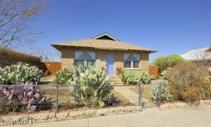Here's your chance to own a piece of history! Clarkdale historic brick bungalow built in 1916, has been lovingly updated including: electric, plumbing, windows, heating and cooling, insulation and roof. This home is full of original charm including Oregon pine floors, kitchen pantry, 9-foot ceilings and period accurate moldings. In addition to the original 2 bedrooms and 1 bathroom, a wonderful seamless addition of a 3rd bedroom/studio/mother-in-law and second full bathroom and kitchenette has been added. Outdoors includes a fully fenced yard with mature low-water landscaping, two side patios, with views of Mingus Mountain and Tuzigoot National Monument. Backyard has a gazebo shade structure, 10 x 12 workshop and room for off street parking.