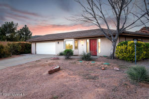 Wonderful chance to own in the beautiful Red Rock Cove West neighborhood, with red rocks so close you can almost touch them! This 3bd/3ba home has been priced to allow room for your own design-styles to come to life. To add extra appeal for this property, there is a huge, nearly 900 sqft, In-Law suite w/separate entrance & 3/4 bath & its own fireplace. Loads of flexibility as it could be used as a furnished VR space (30 day min) or as an in-law suite for a multi-gen home life. Or simply enjoy the entirety of the home yourself as a very private owners suite. This was an addition put on the home in the early 90s, has a permit record, & the square footage is included by Yavapai Cty (see diag. in docs). It has its own HVAC system & water heater too!MORE: