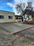 This home has it all! Plenty of space, both indoors and out; and incredible views of Mingus Mountain from the comfort of the courtyard. This incredibly unique home is in the shape of a horseshoe, with the north and south wings joined by a covered patio under a southwestern tile roof. The north wing houses the kitchen, dining area, living room, and main bedroom; and the south wing is where you will find a large family room, two more bedrooms, and bathroom. The possibilities for this home and property are endless!