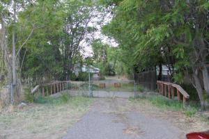 3 acres of irrigated land from the Verde Ditch. The front parcel is .18 acre zoned commercial.There is a well & septic on the property.  Home is uninhabitable.Location, location!
