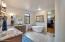 Dual sinks, soaking tub, separate shower, leathered granite counters.