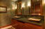 Luxurious artistic finishes with the Venetian plaster walls and granite with leathered top.