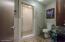Guest Bath with Steam Shower.
